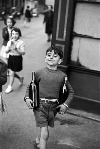 Henri Cartier-Bresson, Boy Carrying a Wine Bottle